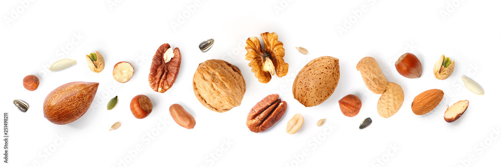 Fototapety, obrazy: Creative layout made of hazelnut nuts, almonds, walnut, peanut, pecan, sunflower seeds on white background. Flat lay. Food concept.