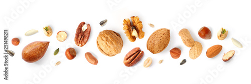 obraz PCV Creative layout made of hazelnut nuts, almonds, walnut, peanut, pecan, sunflower seeds on white background. Flat lay. Food concept.