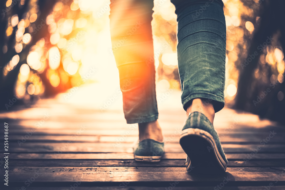 Fototapety, obrazy: Close up woman walk in to the wild with sunset and sunlight background.