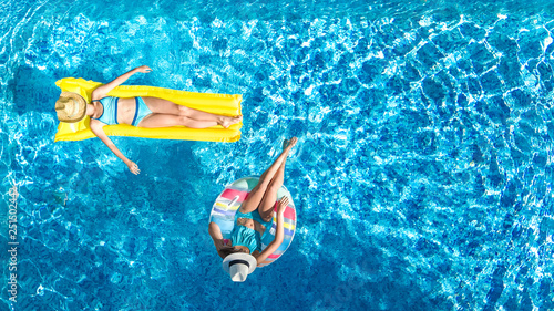 Children in swimming pool aerial drone view fom above, happy kids swim on inflat Canvas Print