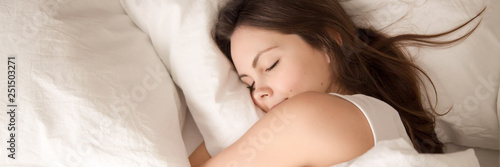 Fotografia, Obraz  Above panoramic view young woman sleeping in bed hugging pillow
