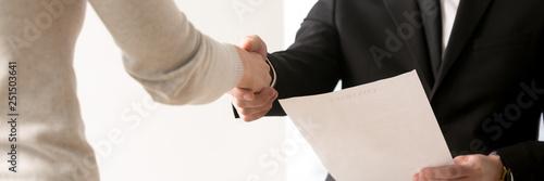 Obraz Horizontal closeup view businesspeople shaking hand starting job interview - fototapety do salonu