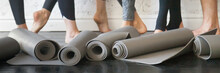 Horizontal Photo People Legs And Rubber Mats In Roll Closeup