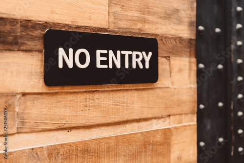 No entry sign on wood wall background. Canvas Print