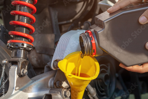 Fotomural  Fill oil to the engine after driving motorcycle