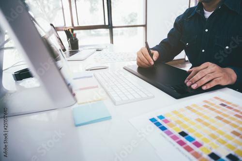 Fotomural  Creative graphic designer using graphics tablet.