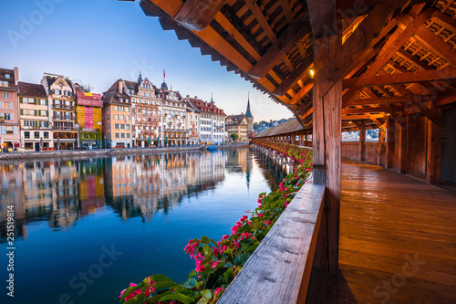 Fototapeta Kapellbrucke historic wooden bridge in Luzern and waterfront landmarks dawn view