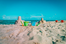 Sand Castles And Kids Toys On Beach Vacation