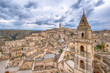 Matera, Basilicata, Italy, landscape at day of the old town (sassi di Matera), European Capital of Culture. Church San Pietro Barisano and duomo cathedral. Unseco World Heritage site