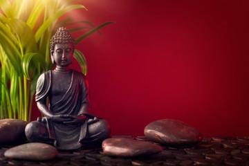 Posąg Buddy i kamienie