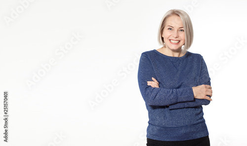 Fotografie, Obraz  Attractive middle aged woman with folded arms on white background