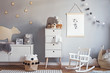canvas print picture - Scandinavian nursery room with mock up poster frame on the grey wall, white furniture, natural teddy bear and toys. Cute modern interior of playroom with white walls, baby accessories and toys.
