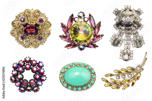 Fotografija A lot of vintage precious brooch on a white isolated background