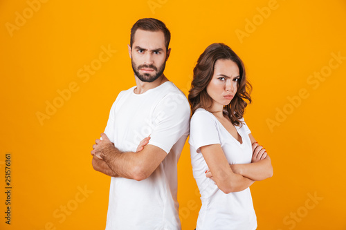 Photo of offended man and woman in quarrel standing back to back with arms folde Wallpaper Mural
