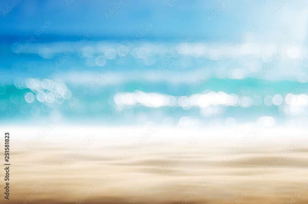 Fototapeta Blur tropical beach with bokeh sun light wave abstract background.
