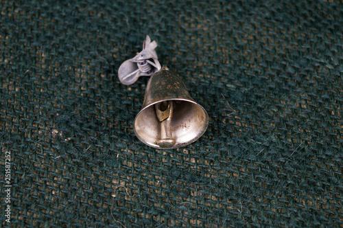 Fotografía  Bells for fishing spinning on a dark green background