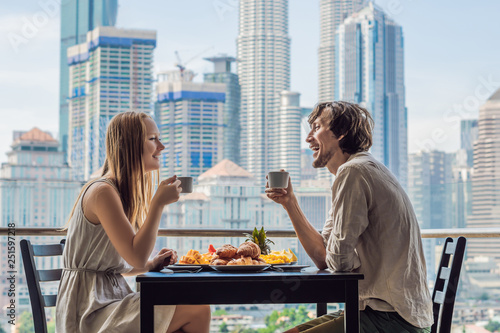 Loving couple having breakfast on the balcony Wallpaper Mural
