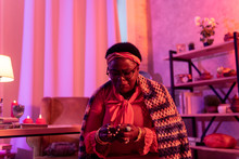 African American Plump Fortune-teller In A Bright Woolen Shawl Holding A String Of Beads