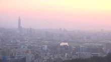 Sunset At Skyline Of Taipei With The Taipei 101 A Plane Is Taking Off Pan. 4K