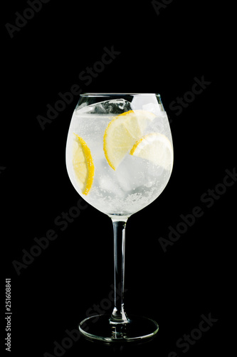 Gin based cocktail in wine glass isolated on black background. Selective focus. Shallow depth of field.