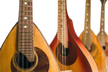 Four Mandolins Close Up. Isolated On A White Background. Selective Focus.