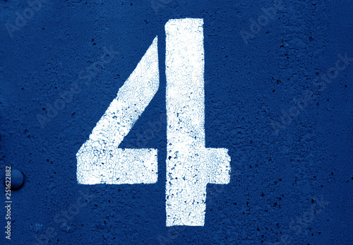 Fotomural  Number 4 in stencil on metal wall in navy blue tone.