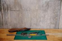 Belt Preparing Tool On Table In Workshop