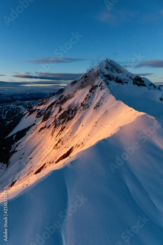 Aerial view of a beautiful Canadian Landscape during a winter sunset. Taken near Squamish, North of Vancouver, British Columbia, Canada. Wall mural