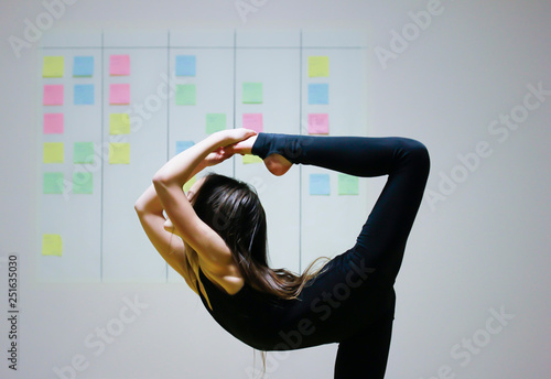 Girl symbolizes flexibility of agile project management approach: she is doing g Canvas Print