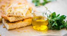 Foccacia Bread With Oregano Herb And Olive Oil.Fresh Italian Foccacia Bread Closeup With Mediterranean Ingredients