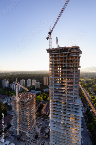 Aerial view of a residential building construction site during a vibrant summer sunset. Taken in Burnaby, Vancouver, BC, Canada. Wall mural
