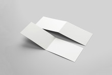 Blank Greeting Cards With Two Wings Isolated On Soft Gray Background. Folded Business Card. 3D Rendering.