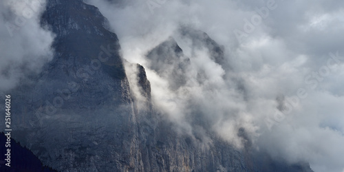 Foto auf Leinwand Rosa dunkel Panoramic view of the cloudy mountains landscape in Lauterbrunnen valley in Switzerland.