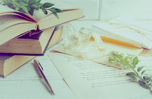 Books, Pen, Poems Of Shakespeare On The Old Wooden Table. The Process Of Writing A Love Letter