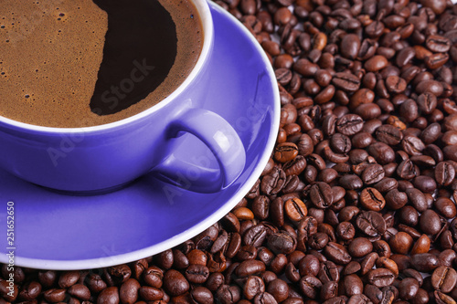 Door stickers Cafe Coffee in purple cup on table surrounded with coffee beans