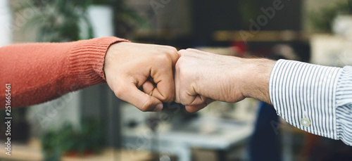 Foto  Male friends greeting each other with fist bump