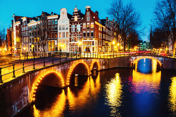 Fototapeta Mosty Night view of canals and bridges in Amsterdam, Netherlands
