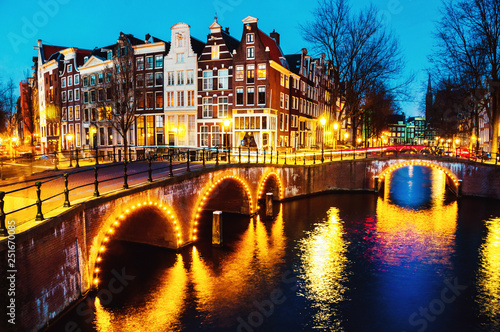 Fényképezés Night view of canals and bridges in Amsterdam, Netherlands