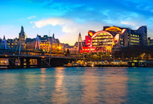 Night View Of The Embankment Tube Station And Blackfriars Bridge Reflected In The Thames River In London, UK