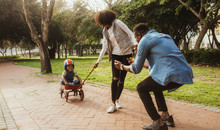 Young Family On Enjoying At Park