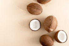 Summer Composition With Coconut. Coconut On Pastel Beige Background. Flat Lay, Top View, Copy Space