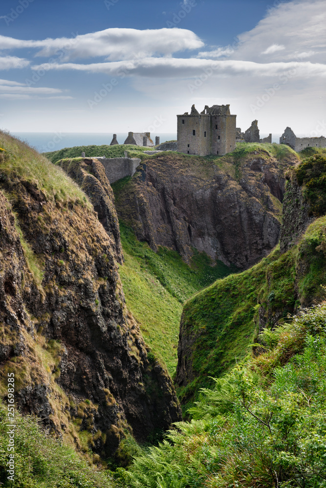 Fototapeta Cliffs at Burn of Halymyres stream leading to Donnottar Castle 13th Century ruins near Stonehaven Scotland UK