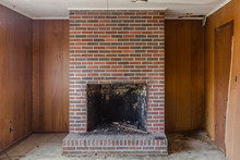 Red Brick Fireplace Set Agains...