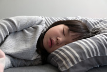 Asian Child Girl Sleeping On T...