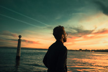 Young Man Watching The Sunset