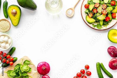 Fototapeta Preparing fresh salad. Vegetables, greens, spices on white background top view copy space frame obraz