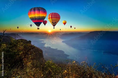 Valokuva  Colorful hot air balloons flying over mountain and Ping River at Pha Daeng Luang