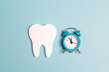 White Paper Tooth With Alarm C...