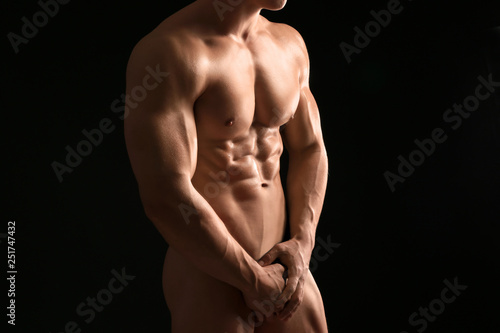 Muscular sexy bodybuilder on dark background - 251747432