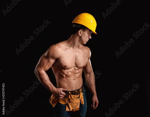 Obraz Muscular worker on dark background - fototapety do salonu